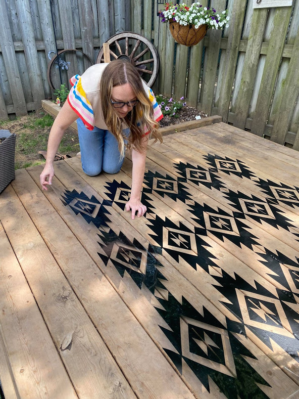 woman working with vinyl to create outdoor carpet
