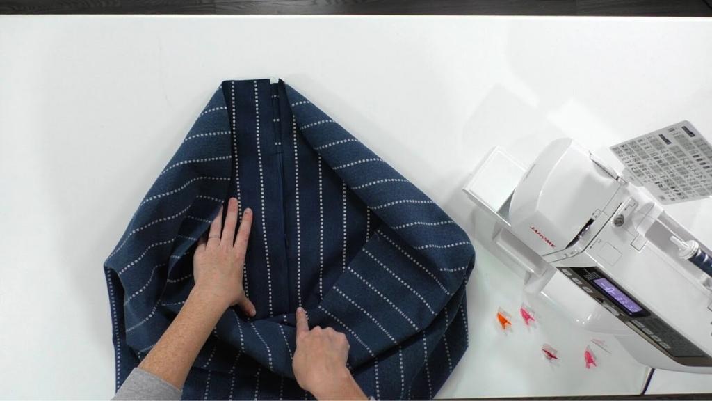 woman sewing zipper into patio cushion