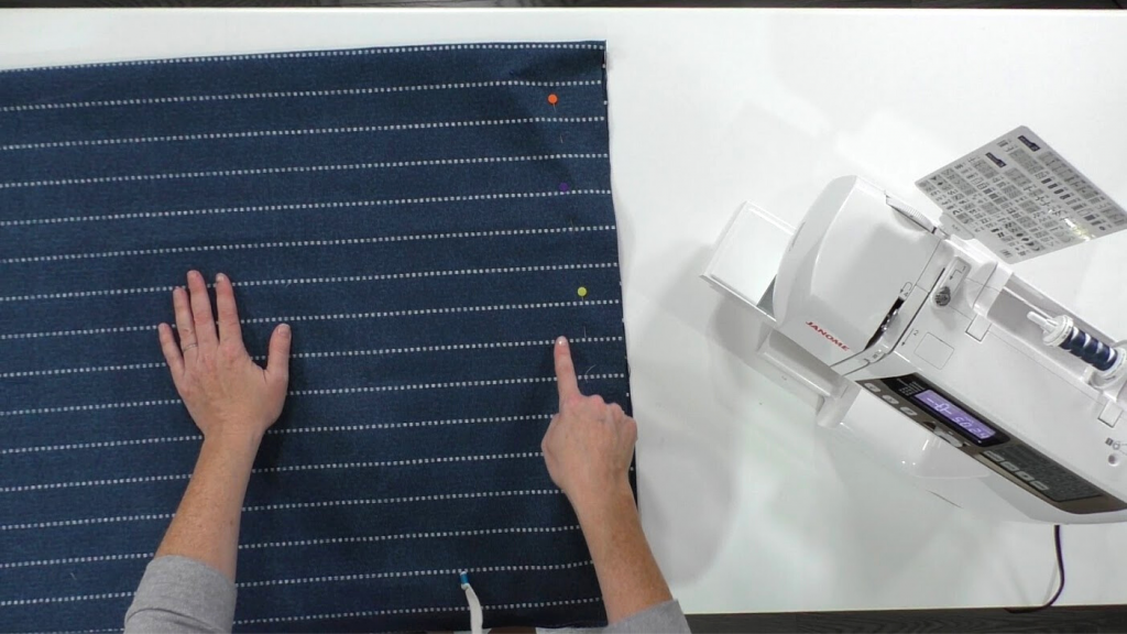 woman sewing raw edges for patio cushion