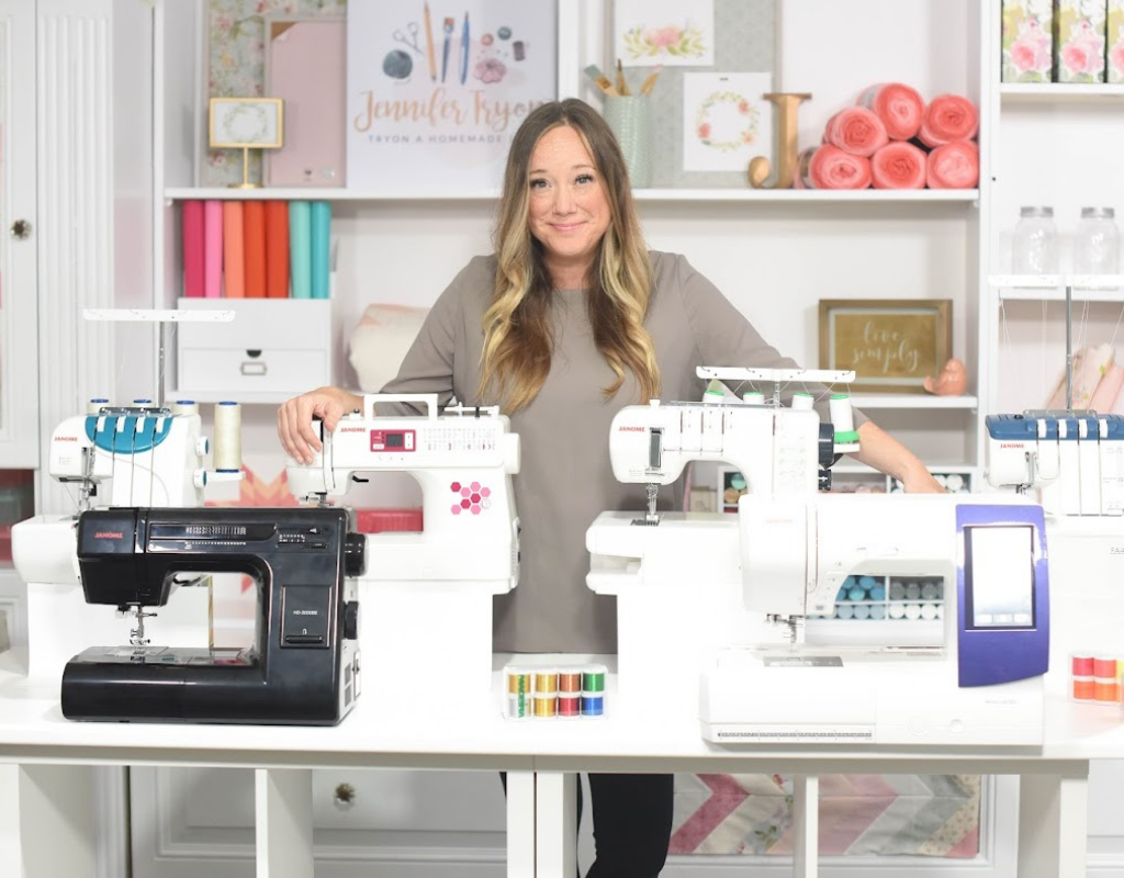 woman with standing next to sewing machines